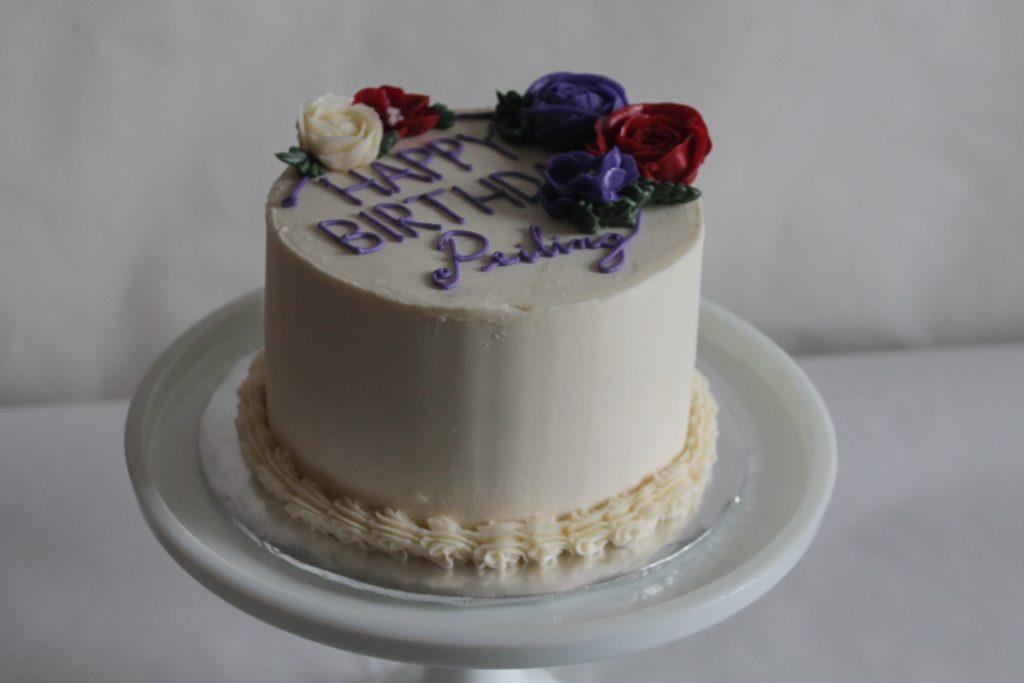 standard birthday cake with buttercream flowers