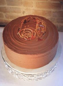 Chocolate Cake with Chocolate Caramel Ganache and Fudgy Chocolate Buttercream frosting topped with caramelized sugar swirls